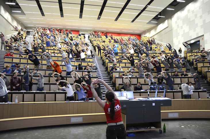 Students in lecture hall doing exercises