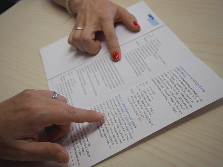 Two hands on a document